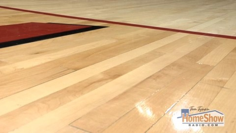 What can I do to restore the hardwood flooring finish after using the wrong product on it?