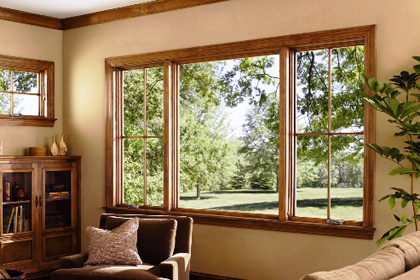 How do I get hard-water stains off my windows?