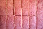What is the best type of insulation to use behind our sheet rock walls after the flood waters?
